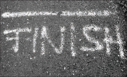 the-word-finish-written-in-white-chalk-on-the-sidewalk