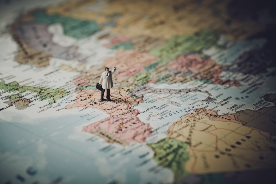 Miniature businessman on map of Europe.